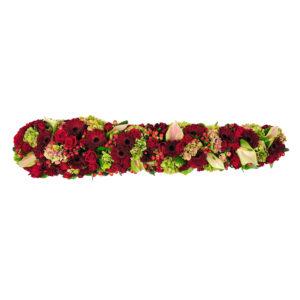 Afscheidsbloemen bloemstuk rode rozen margrieten