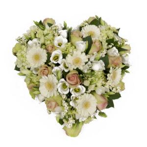 Afscheidsbloemen hart bloemen witte zachtroze kleuren