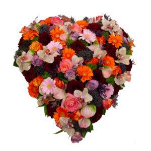 Afscheidsbloemen hart oranje paarse kleuren