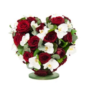 Afscheidsbloemen hart witte orchideeën rode rozen