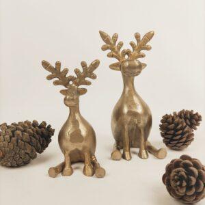 Kerstdecoratie rendieren zittend
